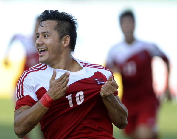 Nepalese football player  Anil Gurung celebrates a goal against India during their SAFF Championship football match in Kathmandu on September 5, 2013. Nepal won 2-1. AFP PHOTO / Prakash MATHEMA        (Photo credit should read PRAKASH MATHEMA/AFP/Getty Images)